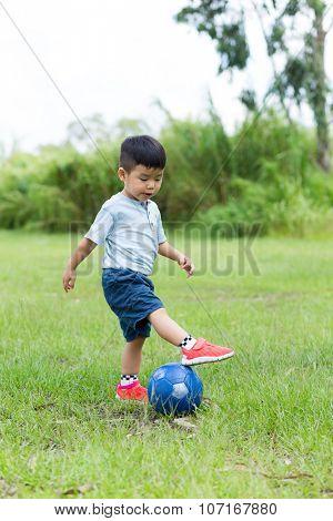 Asian Baby boy play soccer ball at park