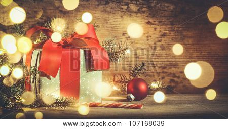 Christmas gift box and decorations on wooden background