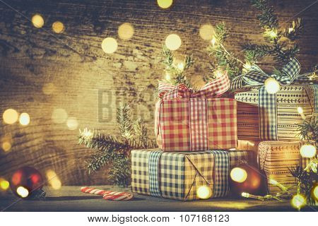 Christmas gift boxes and decorations on wooden background