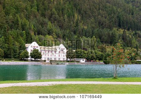 ACHENKIRCH, AUSTRIA - SEPTEMBER 2014 : The Scholastika hotel on Achensee (Lake Achen) in Achenkirch, Austria on September 24, 2015. The facade has frescoes of hunters.