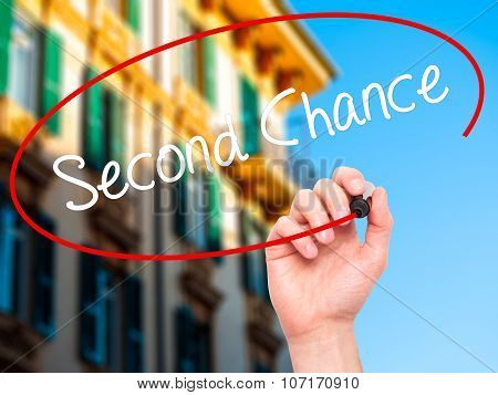 Man Hand writing Second Chance with black marker on visual screen.