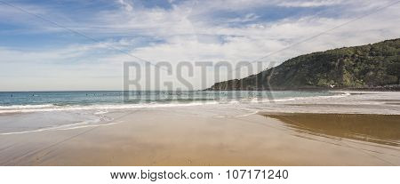 Surfers in the Beach of San Sebastian, wide angle, Spain