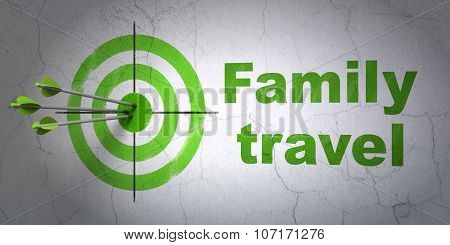 Travel concept: target and Family Travel on wall background