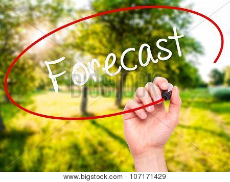 Man Hand writing Forecast with black marker on visual screen.