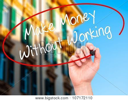 Man Hand writing Make Money Without Working with black marker on visual screen.