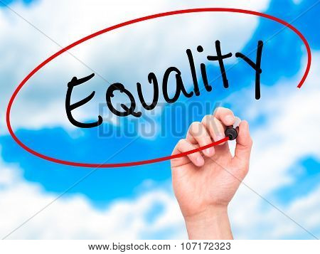 Man Hand writing Equality with black marker on visual screen