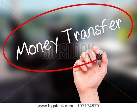Man Hand writing Money Transfer with black marker on visual screen.