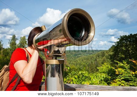 Young Woman Looking Through Tourist Telescope, Exploring Landscape. Selective Focus On Telescope.