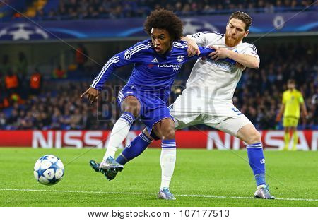 LONDON, ENGLAND - NOVEMBER 04 2015: Vitorino Antunes of Dynamo Kyiv fouls Willian of Chelsea during the UEFA Champions League match between Chelsea and Dynamo Kyiv at Stamford Bridge