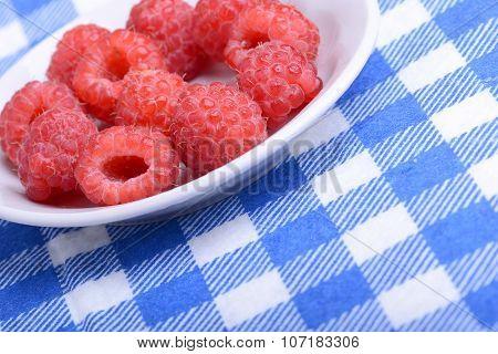 Fresh Raspberries. Closeup Of Fruits On A White Plate