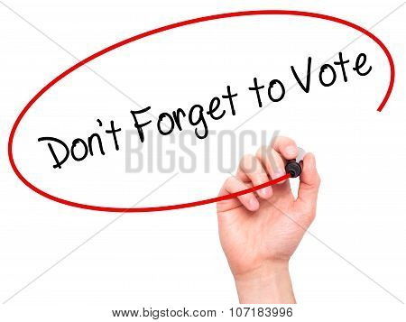 Man Hand writing Don't Forget to Vote with black marker on visual screen.