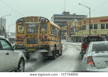 School bus in traffic on a snowy Canadian street