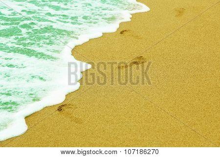 Human Traces On Sandy Beach Near Sea Surf.