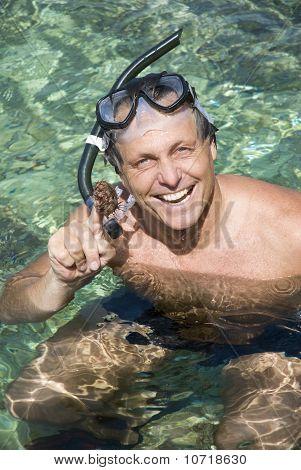 Happy man snorkelling