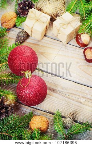 Toys For The Christmas   Tree And Pine Cones On Old Wooden Background  New Year