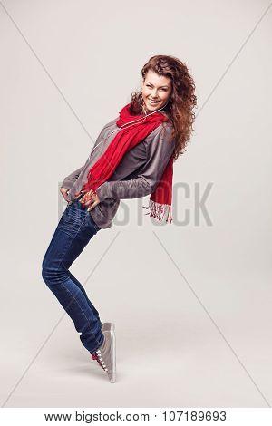 Dancing girl with headphones on light background
