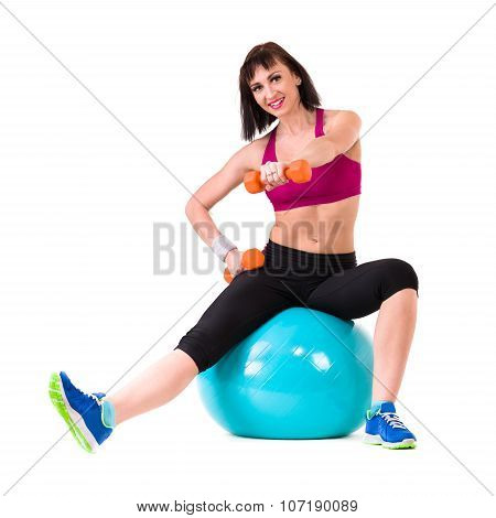Young smiling woman makes exercise with fitball, full length portrait isolated over white