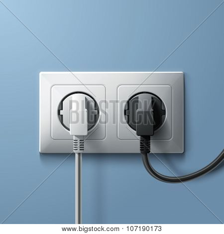 Electric white and black plugs with plastic socket on blue wall background