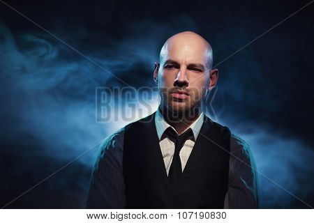 Bald Man On A Dark Background