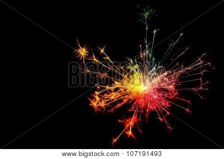 Sparkler. Christmas and newyear party sparkler on black