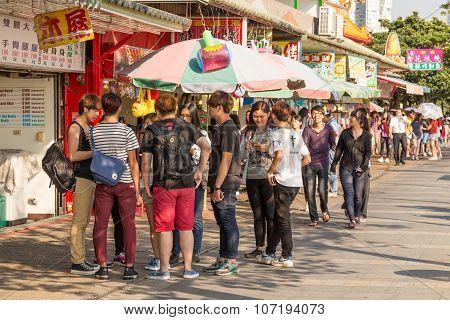 Shoppers Walking In Danshui Pedestrian Shopping Area
