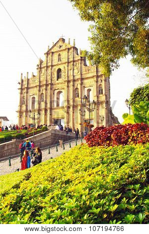 Saint Paul's Cathedral in Macau and people near it
