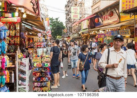 Shoppers Walking Through Tamsui Pedestrian Shopping Area