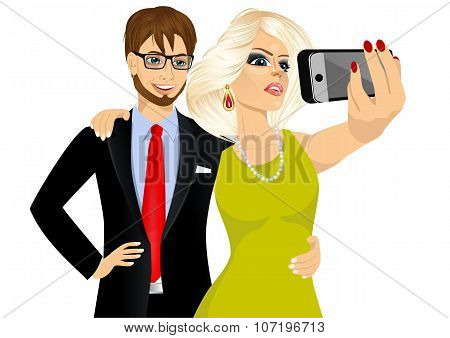 happy couple taking a selfie using her smartphone