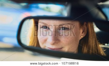 Female Driver In The Rear View Mirror