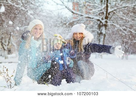 happy mother and children in winter park