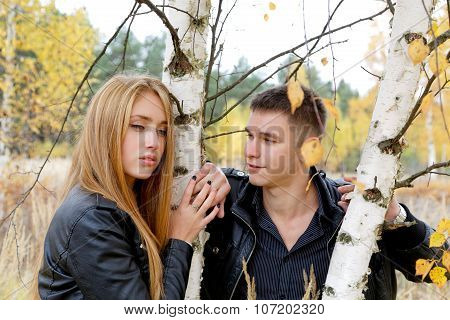 Boy And Girl At A Birch In Autumn