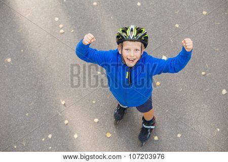 Happy boy excited about roller skating