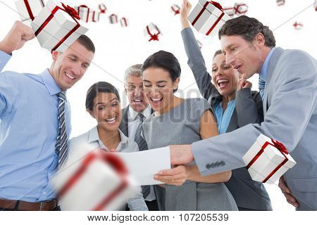Business team celebrating a new contract against white and red gift box