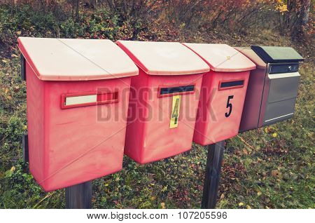 Old Red Post Boxes On A Roadside In A Row