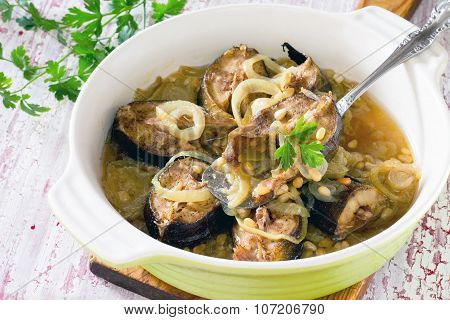 Grilled Mackerel Fish Baked With Onions And Pine Nuts