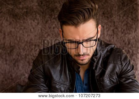 Closeup Portrait Of Modern Man With Glasses