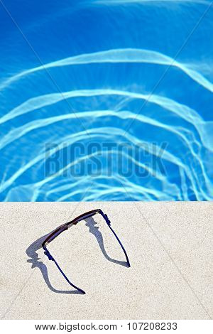Sunglasses At The Swimming Pool