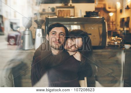 Vintage couple hugs and laughing .Coffee shop