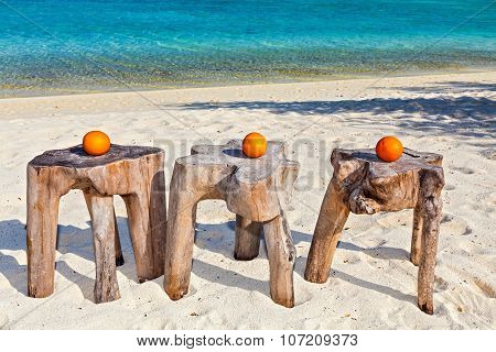 Three Oranges Are On Original  Beach Tables