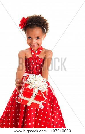 Smiling Girl With Curls Hair Give A  Gift Box In Hands. Happy  New Year And Christmas Holidays