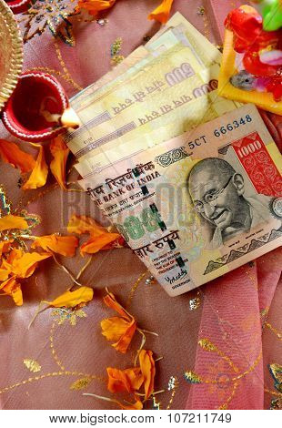 Indian rupee notes placed in a Diwali Puja. Hard currency worshiped as a God of wealth-Laxmi in India.