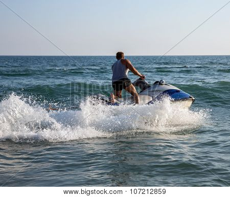 Silhouette Of Man On Jet ski At Sea