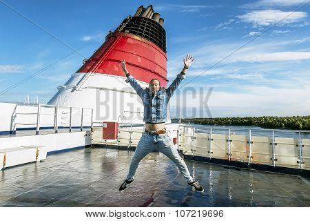 The Man In The Jump Poses On The Upper Deck Of The Ferry