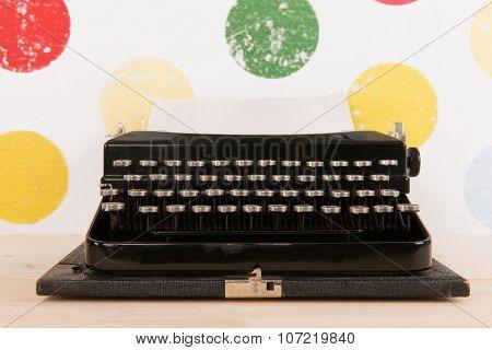 Vintage black old typewriter on colorful background