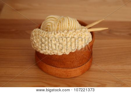 Knitted fabric in a birch-bark bowl