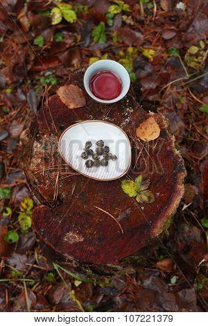 Bowl of tea and tea leaves