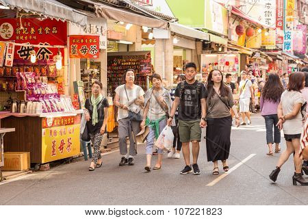 Street Vendors And Shoppers At Danshui Shopping Area