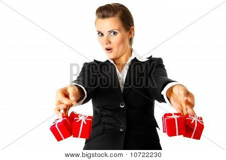 Excited modern business woman holding presents in hands
