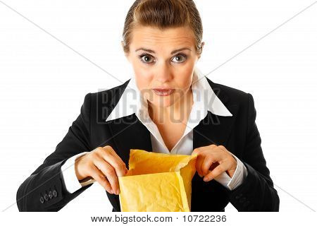 Interested modern business woman checking parcel