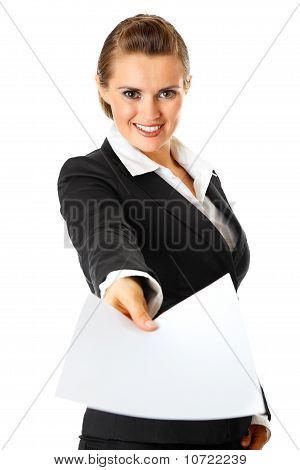 Smiling modern business woman giving empty white paper